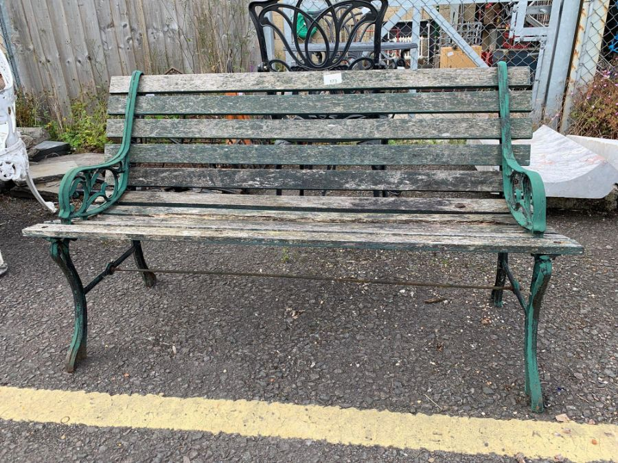Garden bench with green painted metal bench ends