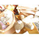 Wicker basket containing various teddies