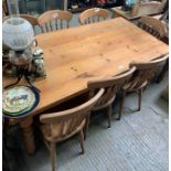 Rectangular pine kitchen table together with 8 cha