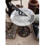 Metal sundial on metal base