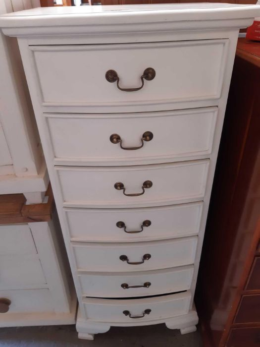 White painted tallboy with 7 short drawers and swi