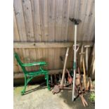 Pair of green painted bench ends together with var