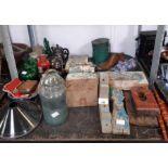 Shelf of wooden moldings, teapots, earthenware etc