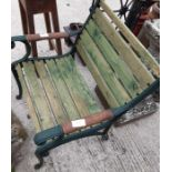 Green painted garden armchair with green painted e