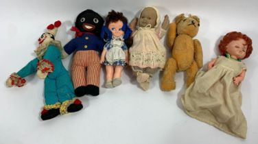 A collection of vintage dolls and soft toys