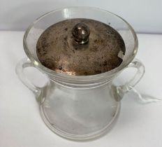 A two handled glass preserve pot with a silver pul