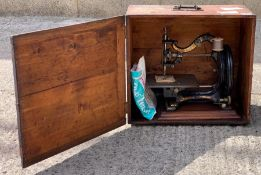 A 19th century Agenoria sewing machine, by the Fra