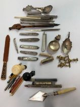 A collection of writing instruments, including dip