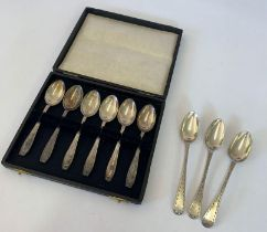 A cased set of six silver coffee spoons; and a mat