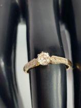 A diamond single stone ring, stamped '18ct & Plat'