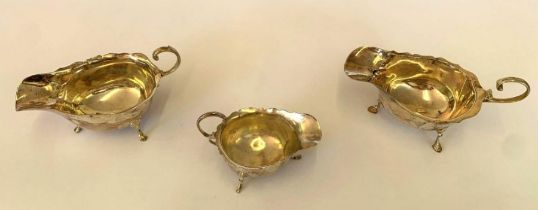 A matched pair of Asprey & Co Ltd silver sauceboat