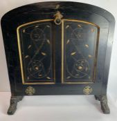 A 19th century ebonised fire screen, with rounded