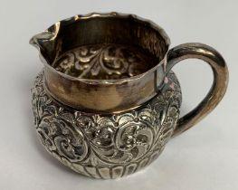 A Victorian silver small cream jug, by E. S. Brown