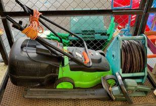 A green electric lawn mower, a Black & Decker elec