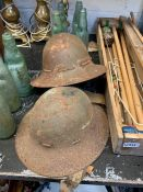 2 military helmets, possibly French, along with a