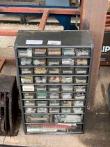 Metal set of drawers with various contents to incl