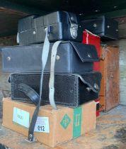 Half a shelf of boxed testing equipment