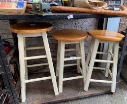 3 wooden stools