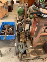 Lathe along with a metal stand and cogs