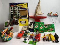 A collection of vintage toys including tin plate s