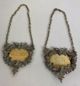A pair of silver wine labels, by J Figg & Son Ltd,