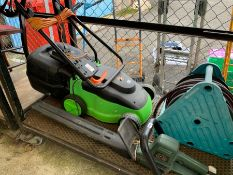 A green electric lawnmower, Black & Decker electri