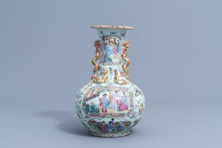 A Chinese Canton famille rose bottle vase with relief design, 19th C.