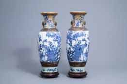 A pair of Chinese blue and white Nanking crackle glazed vases with peacocks, 19th C.