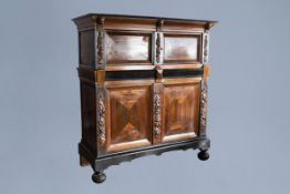 A Dutch wooden four-door cupboard, 17th C. and later