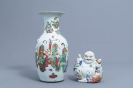 A Chinese famille rose figure of Buddha with children and a vase with figures, 19th/20th C.