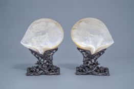 A pair of Chinese carved mother-of-pearl shells on wooden stands, 19th C.