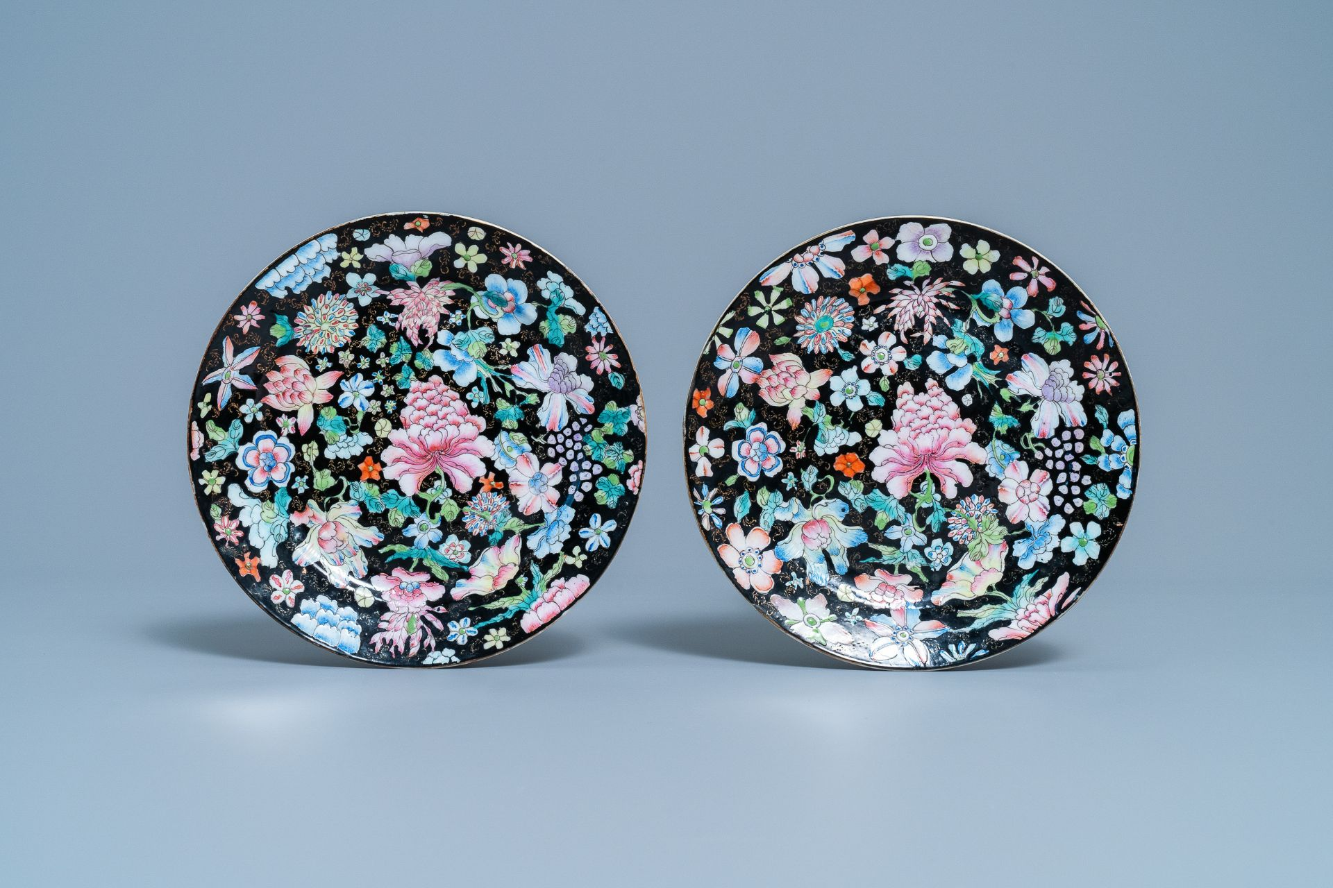 A pair of Chinese famille rose 'millefleurs' plates and a blue ground plate, 19th/20th C. - Image 2 of 5