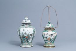 Two Cinese famille verte vases and covers with birds and butterflies, 19th/20th C.