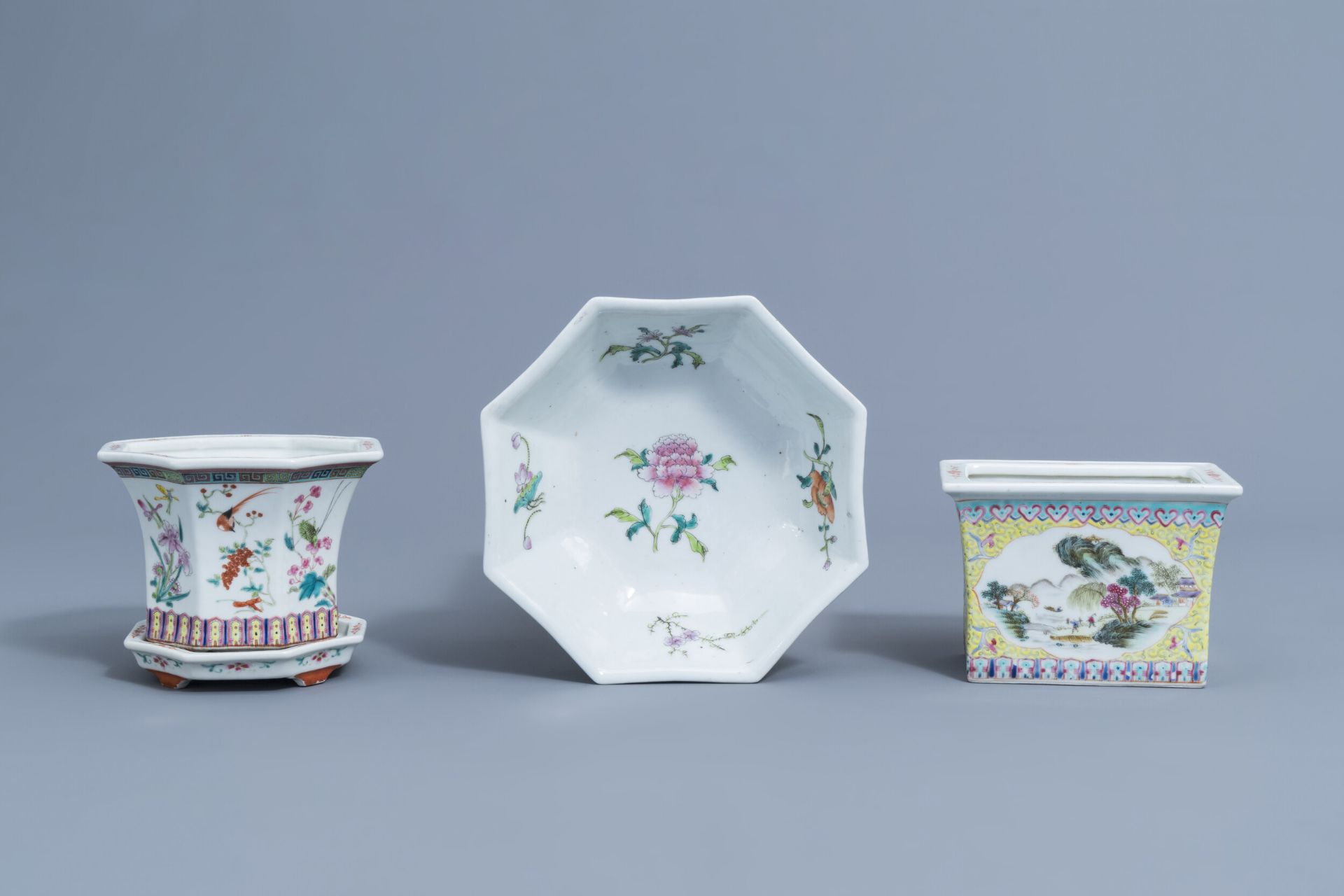 Two Chinese famille rose jardinires and a bowl with floral design, 20th C.