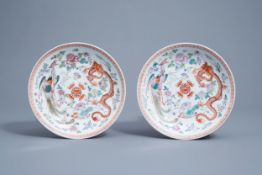 A pair of Chinese famille rose 'dragon and phoenix' chargers, Qianlong mark, 20th C.