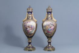 A pair of large French Svres styles vases and covers with gallant scenes and landscapes, 20th C.