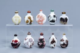 Nine Chinese overlay glass snuff bottles and one in agate, 20th C.