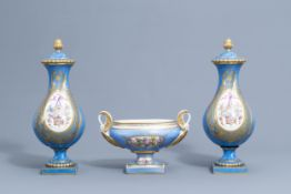 A pair of French 'bleu celeste' Svres manner vases and an Empire style centrepiece, 19th/20th C.