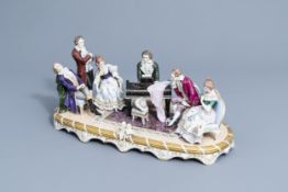 A group with a piano concerto in polychrome decorated Saxon porcelain, Sitzendorf mark, 20th C.