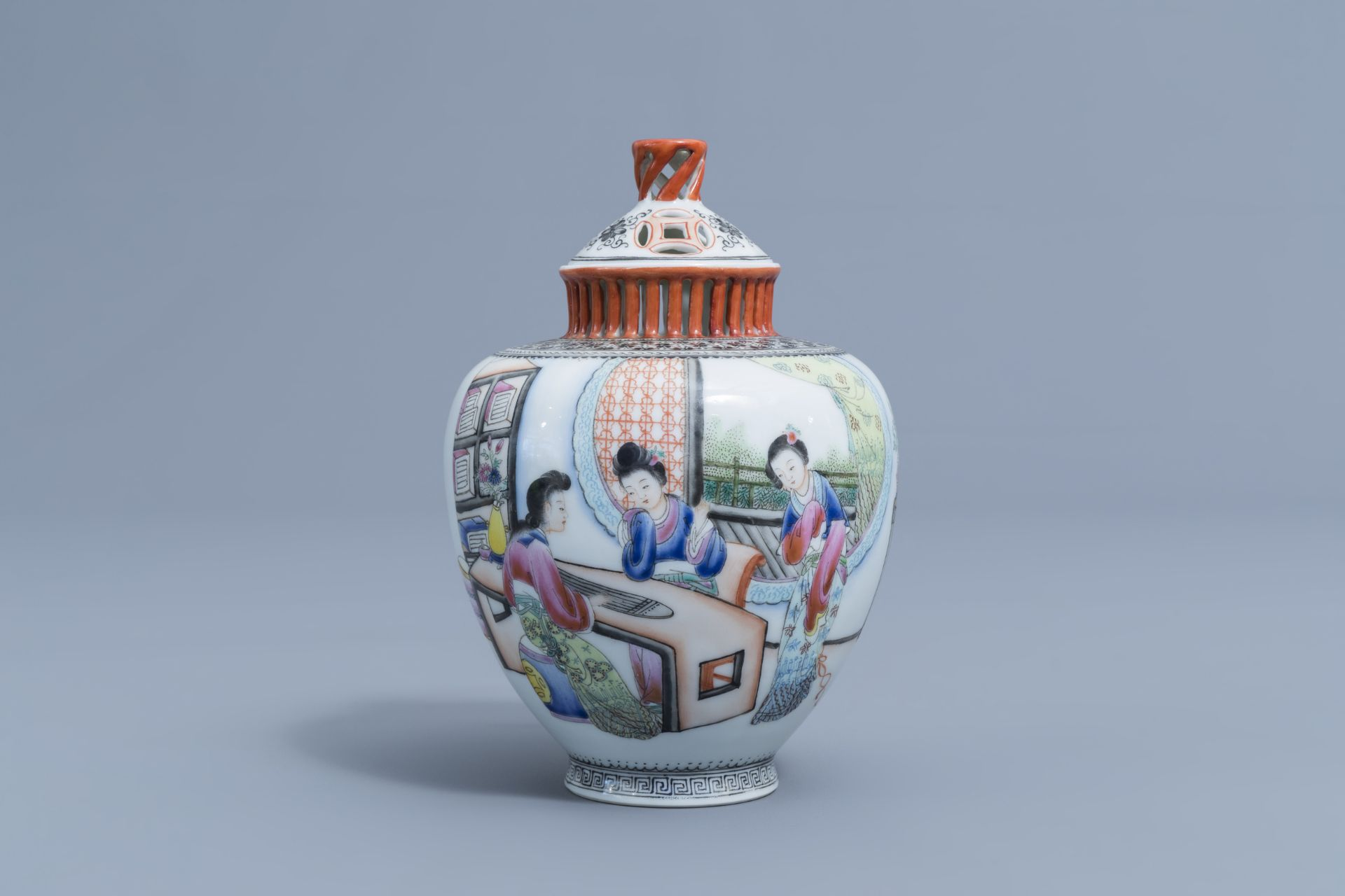 A Chinese famille rose vase and cover with ladies playing music, Qianlong mark, Republic, 20th C. - Image 2 of 7