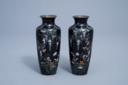 A pair of fine Japanese cloisonne vases with a bird among blossoming branches, Meiji, 19th C.