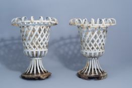A pair of wrought iron reticulated garden urns, ca. 1900