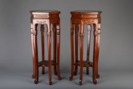 A pair of Chinese carved wood and marble hexagonal vase stands, 20th C.