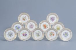 A set of eleven French plates with gilt and polychrome floral design, Svres mark, 19th C.