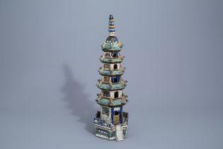 A Chinese three-piece glazed pottery pagoda, 19th C.