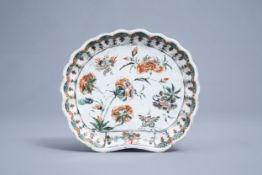 A Chinese shell shaped famille verte dish with floral design, Kangxi