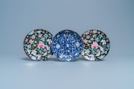 A pair of Chinese famille rose 'millefleurs' plates and a blue ground plate, 19th/20th C.