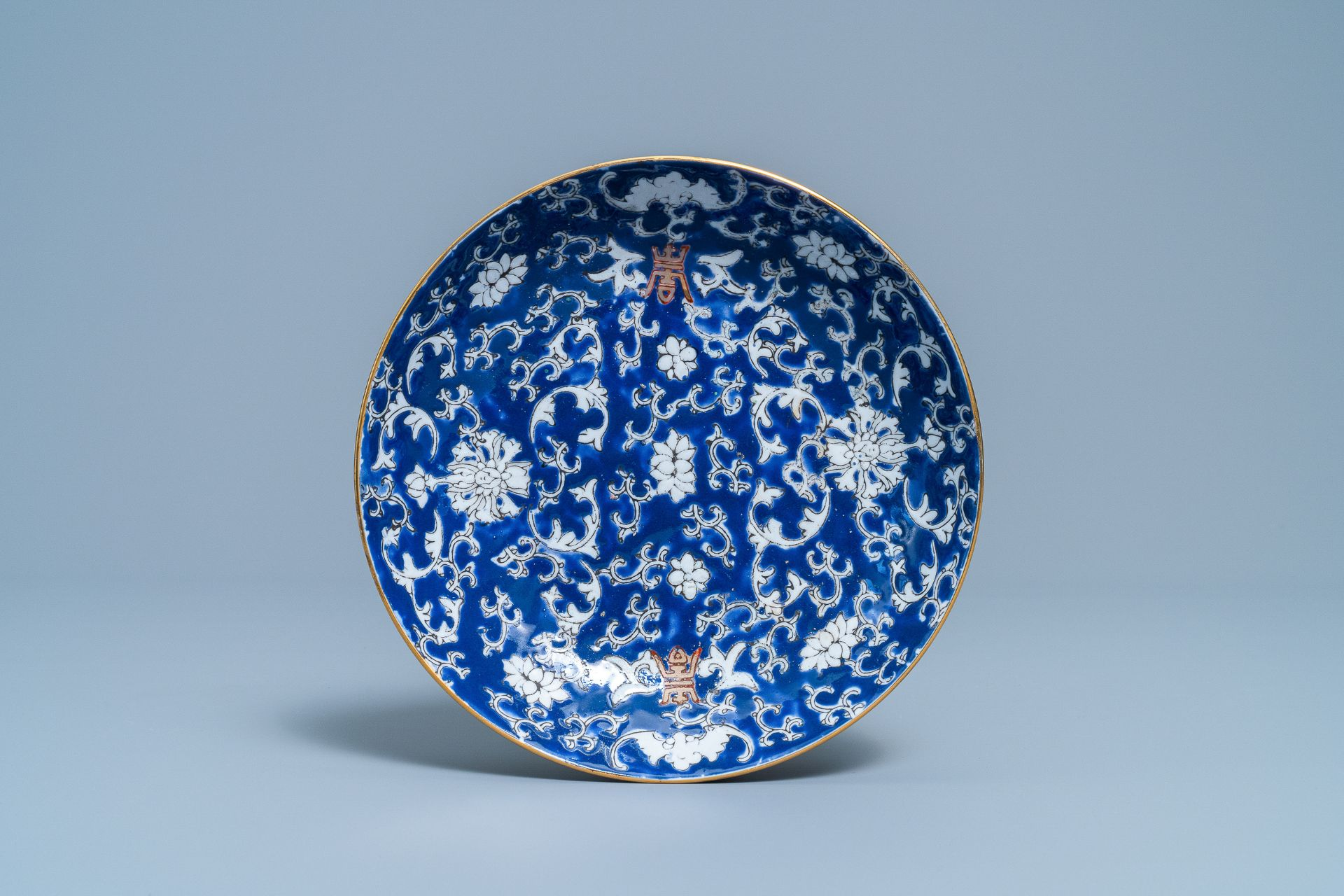 A pair of Chinese famille rose 'millefleurs' plates and a blue ground plate, 19th/20th C. - Image 4 of 5