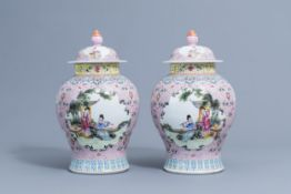 A pair of Chinese famille rose vases and covers with ladies, Qianlong mark, 20th C.