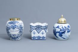 A Dutch Delft blue and white tobacco jar, a French jardinire and a Chinese ginger jar, 18th C.